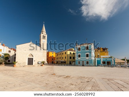 Waterfront square in Fazana. The old church - stock photo