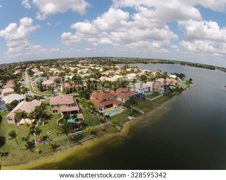 Waterfront suburban homes in Florida aerial view - stock photo