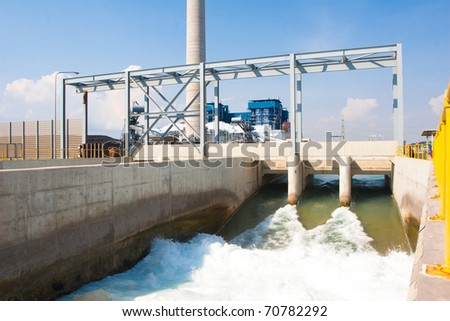Watergate draining clean water to the river after passed wastewater treatment systems - stock photo