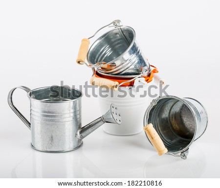 watering and bucket on a white background - stock photo