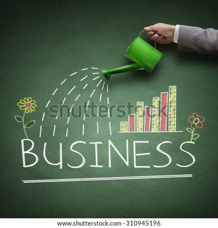 Watering can and word business drawn on a blackboard concept for business growth, investment, savings and making money - stock photo