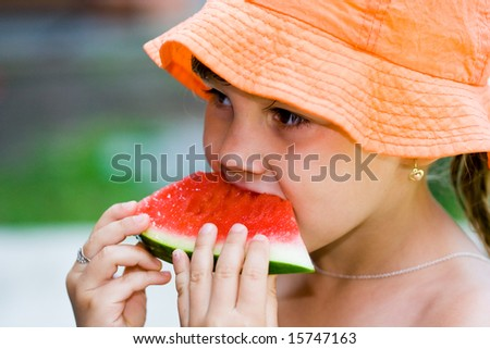 Watermelon and girl - stock photo