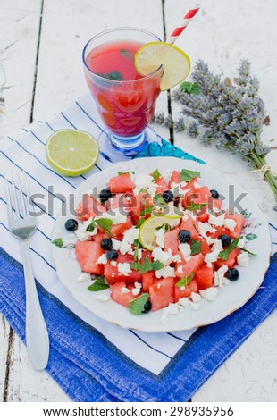 Watermelon and goat cheese salad served in the plate,selective focus  - stock photo