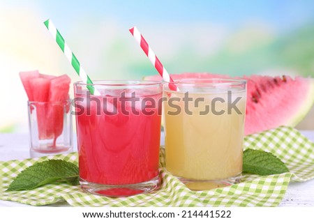 Watermelon cocktail and melon smoothie on wooden table on natural background - stock photo