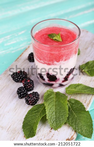 Watermelon cocktail in glass on wooden table - stock photo