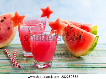 Watermelon drink in glasses with slices of watermelon in star shape - stock photo