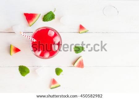 watermelon juice and watermelons slices on wooden white background, top view, flat lay  - stock photo