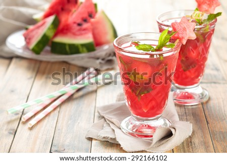 Watermelon juice with mint and ice on wooden rustic  table. - stock photo