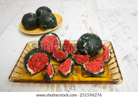 Watermelon like cake dessert - stock photo