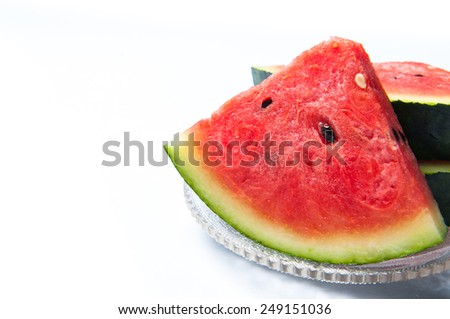 Watermelon on dish glass isolated - stock photo