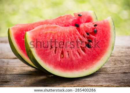 Watermelon slices on the wooden table  - stock photo