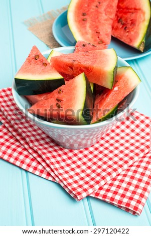 Watermelon slices on wooden vintage background. - stock photo