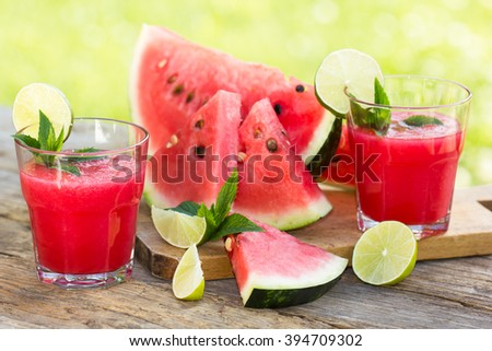 Watermelon smoothies with lime and mint  - stock photo