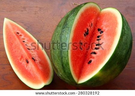 watermelon. watermelons slice on wood background. cool and juicy piece of watermelons. small cut of watermelons on wood table.  - stock photo