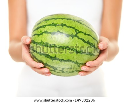 Watermelon. Woman showing whole watermelon on isolated white background. Closeup of water melon. - stock photo