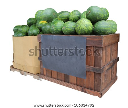 watermelons in crate and box on display for sale with blank chalkboard sign - stock photo