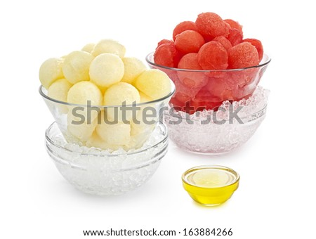 Watermelons & Melons balls with honey on white background - stock photo