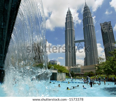 Waterpark and Petronas Twin Towers, Kuala Lumpur, Malaysia - stock photo