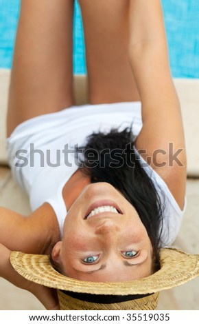 Waterpool sitting woman with feets in water big smiling - stock photo
