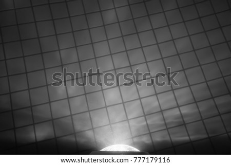 Waterproof floodlight on the wall of the night pool - black and white