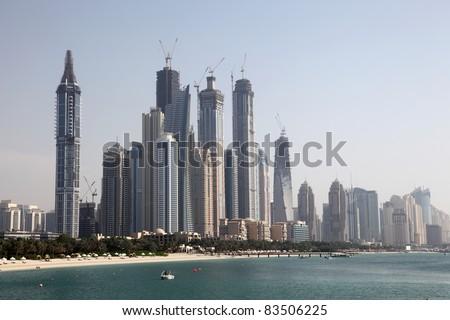 Waterside highrise buildings in Dubai Marina, United Arab Emirates - stock photo