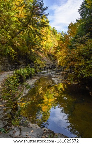 Watkins Glen gorge in New York during fall. A beautiful 1.75 mile long gorge with dozens of waterfalls along a stone walkway.