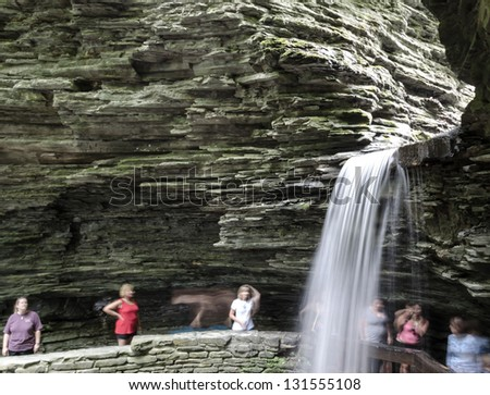 WATKINS GLEN, USA - JULY 7: People look at Cavern Cascade on July 7, 2012 in Watkins Glen Park. The centerpiece of the park is a 400-foot-deep narrow gorge cut through rock by a stream � Glen Creek.