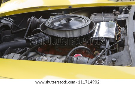 WAUPACA, WI - AUGUST 25: Engine of a yellow 1975 Chevy Corvette Stingray classic car at the 10th Annual Waupaca Rod & Classic Car Club Car Show on August 25, 2012 in Waupaca, Wisconsin. - stock photo