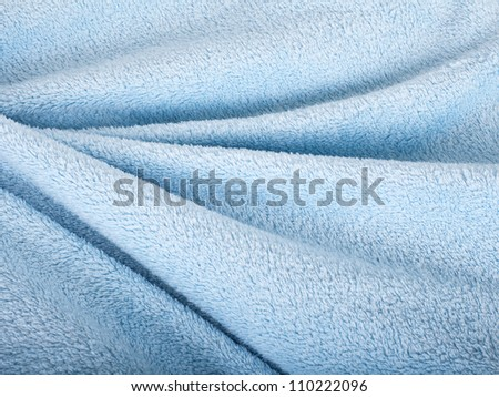 Wave background of blue fur texture. - stock photo