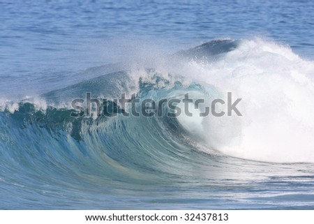 wave breaks along the shore - stock photo