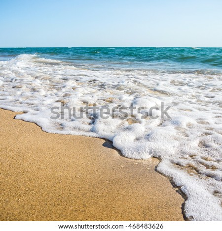 Wave bubbles and golden sand,happy summer holiday