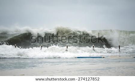 Wave crashing against pool - stock photo