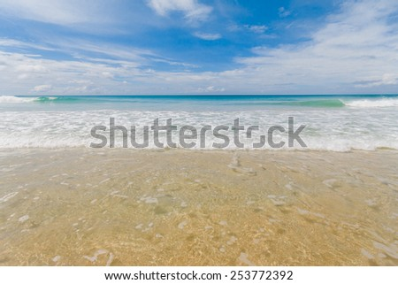 Wave of crystal clear water on the beach. - stock photo