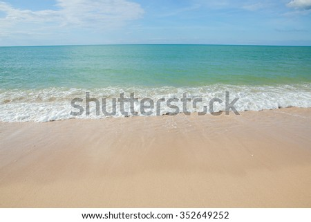 Wave of the sea on the sand beach at Thailand.