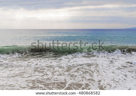 Wave on sea with beach background