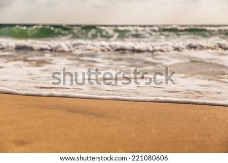 Wave on the beach - stock photo