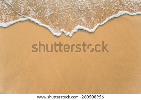 Wave on the sand beach background - stock photo