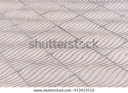 Wave pattern of stone tile on the pavement in urban park. - stock photo
