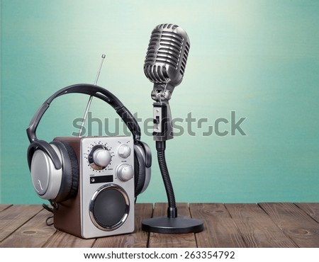 Wave. Retro radio, red microphone, headphones on table old style photo - stock photo