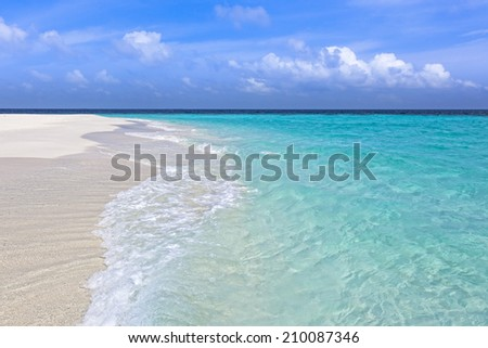 Wave rolling in on a beautiful tropical sandy beach, maldives islands - stock photo