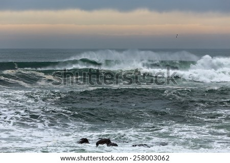 Wave spray at dusk. Northern Portuguese coast. - stock photo