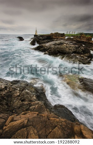 wave, storm on the lighthouse - stock photo