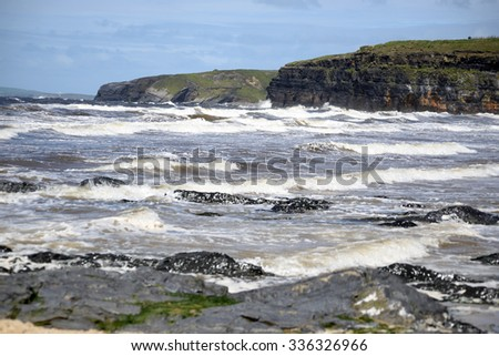 waves and cliffs on the wild atlantic way in Ballybunion county Kerry Ireland - stock photo