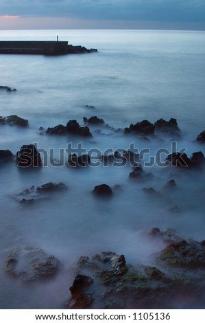 Waves and rocks - stock photo