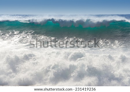 Waves breaking on the shore of Madeira - stock photo