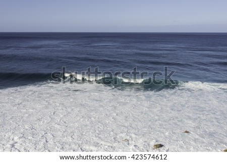 Waves breaking on the shore of Madeira island on Portugal coast mear Sao Vincence - stock photo