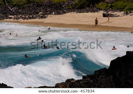 Waves coming ashore on Oahu's winward (east) side at Makapuu Beach. - stock photo