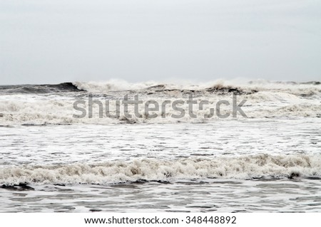 Waves crash during a storm - stock photo