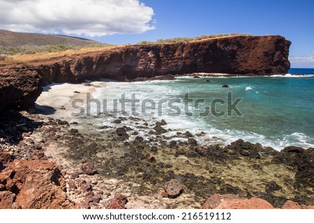 Waves crash on the beach in Shark's Cove in Lanai - stock photo