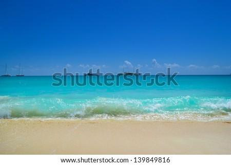 Waves Crashing into a Beautiful Tropical Caribbean Island Beach - stock photo